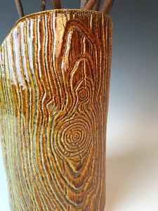 detail of pottery faux wood vase