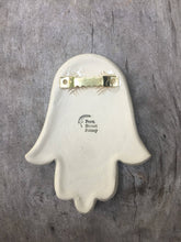 Load image into Gallery viewer, showing the back of a ceramic Hamsa wall hanging, with sawtooth hanger on the back.