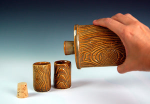 A different set of shot glasses, made by the artist. lumberjack, woodgrain style, shown with matching handmade flask