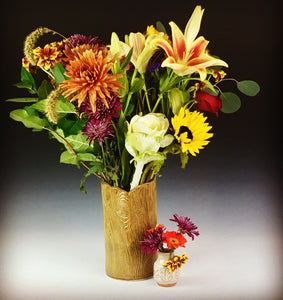 "2"" bud vase shown with daisies and a lager woodgrain vase"