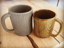 Load image into Gallery viewer, pottery mug, carved to look like woodgrain. photo of before and after firing to show the raw clay and the shrinkage amount.