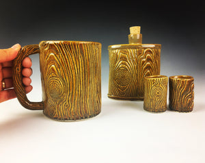 woodgrain, lumberjack style pottery with woodgrain texture. hand built pottery mug, flask and shot glasses