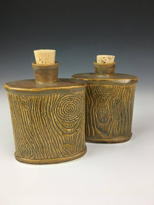 two pottery lumberjack flasks with cork stoppers