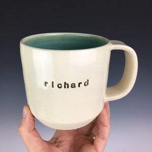 "pottery mug with custom text ""richard"". white mug with green interior"