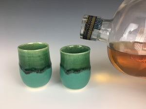two emerald city green shot glasses thrown on the pottery wheel