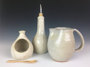 kitchen set in speckled white glaze. salt cellar, oil cruet, and pottery pitcher.