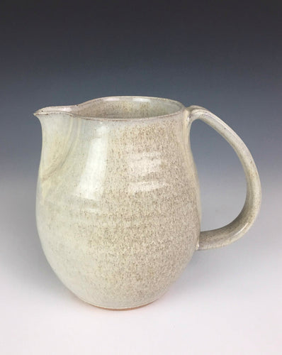 Pottery pitcher, wheel thrown in red stoneware clay, glazed in white speckled glaze