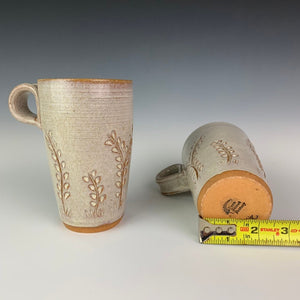 pottery travel mug, showing the bottom diameter of a typical mug