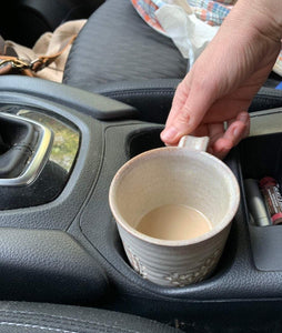 pottery travel mug in the cup holder in the car