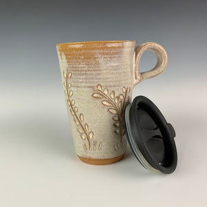 wheel thrown pottery travel mug with vine carved pattern, shown here with it's fitted lid