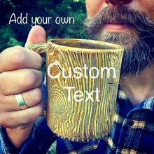 Load image into Gallery viewer, woodgrain textured pottery mug with customizable text added. appears as initials carved into a tree trunk, or name in a heart carved into a tree