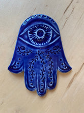 Load image into Gallery viewer, Hamsa wall hanging in cobalt blue with vine patterns carved in. ceramic, approximately 5""