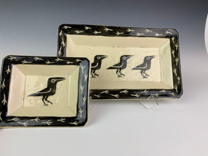 two rectangular crow platters. stoneware pottery with sgraffito carvings of crows and crow footprints around the edges. large and small size.