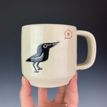 Load image into Gallery viewer, Crow love mug. wheel thrown mug with a crow painted and carved in, and a heart in a speech bubble stamped and glazed with red.