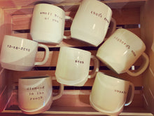 Load image into Gallery viewer, a collection of pottery mugs with customized text
