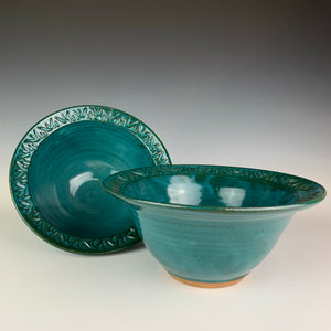 two carved rim serving bowls in teal.