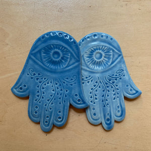 ceramic hamsa wall hanging, hand carved, shown in Sky blue