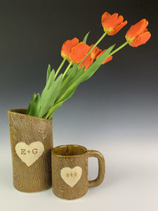lumberjack vase and mug. pottery mug with woodgrain texture, heart and initials carved into surface