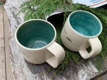 Load image into Gallery viewer, two custom text mugs with different colors inside. the mug on the right shows the mottled-green upgrade, the mug on the left has the turquoise (standard)