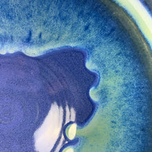 "Load image into Gallery viewer, detail photo of  Fern Street Pottery's ""blue world glaze"" on a wheelthrown bowl.  Cobalt Blue glaze with light, bright turquoise dripping and melting from the rim."