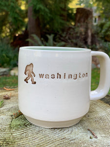 "custom made pottery mug with text ""washington"" and a sasquatch"