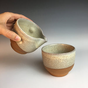 wheel thrown pottery cream and sugar set, shown here as the artist demonstrates pouring. red clay, white speckled glaze