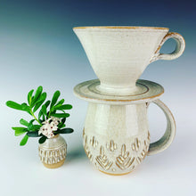 Load image into Gallery viewer, carved bud vase shown with carved mug and coffee pour over in speckled white glaze. all were thrown on the potters wheel by meredith at Fern Street Pottery