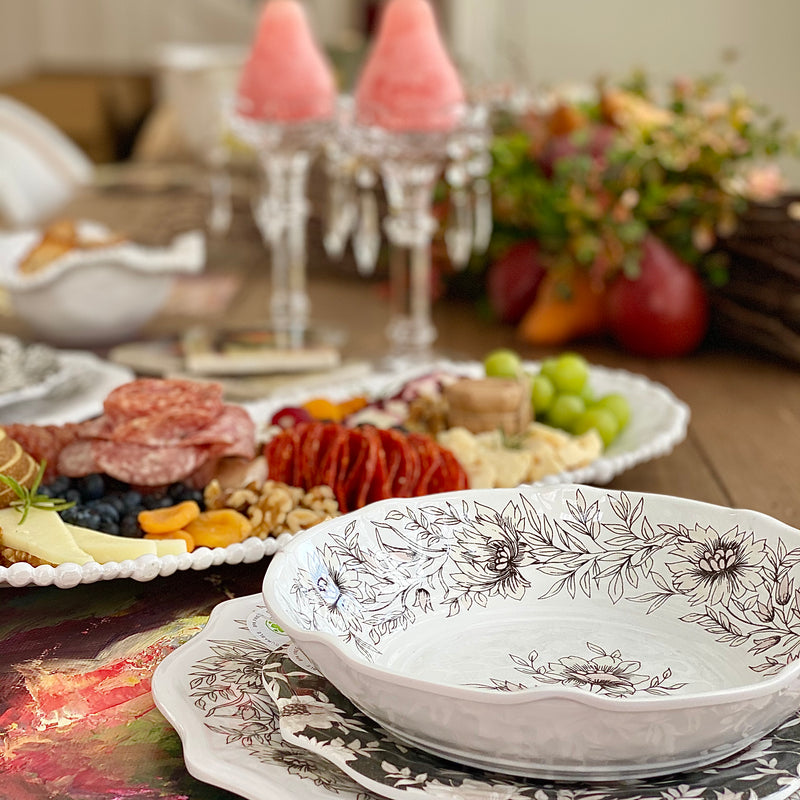 Elegant table setting with dinnerware, candles and white melamine charcuterie tray by Beatriz Ball.