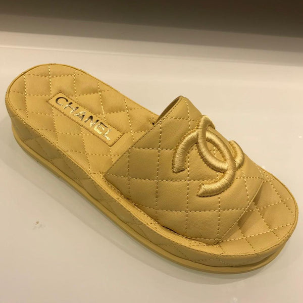 CHANEL yellow mules Spring-Summer 2021