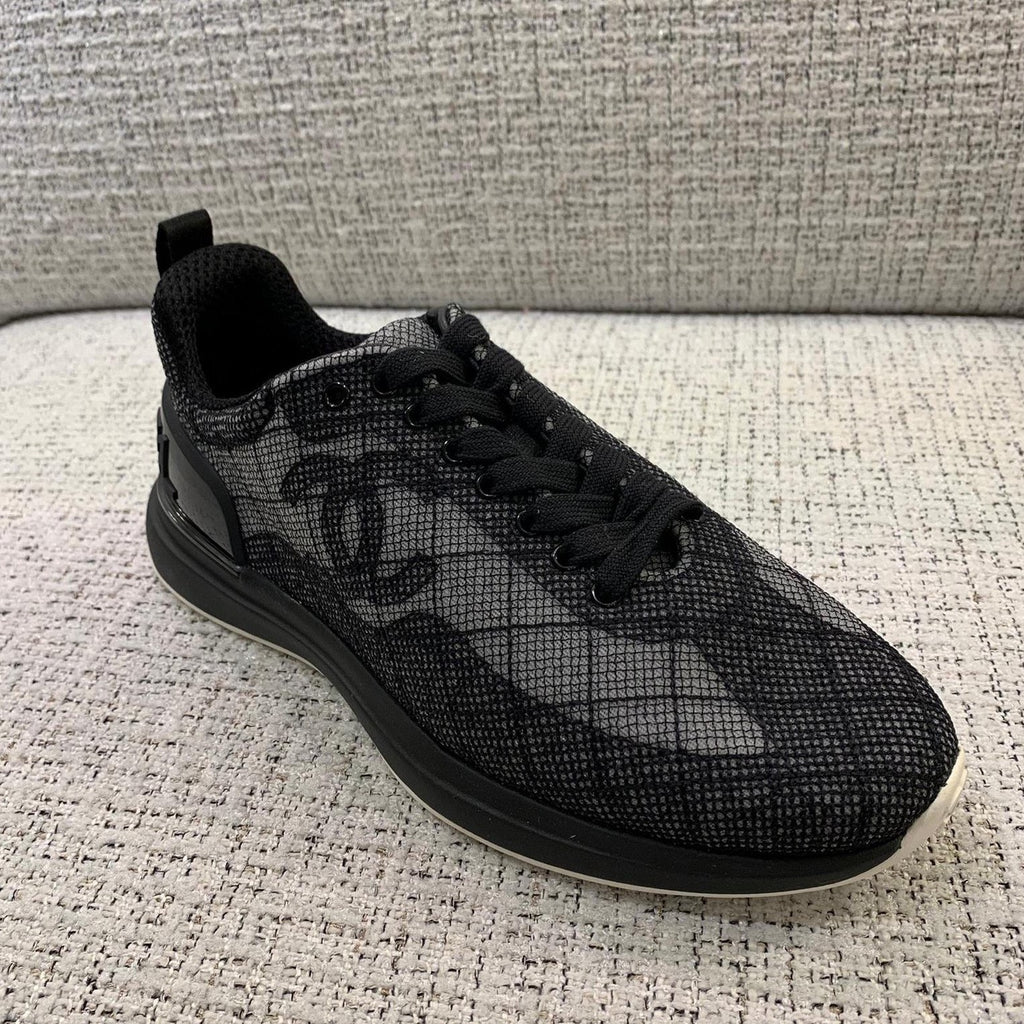 CHANEL black embroidered mesh sneakers Cruise 2021