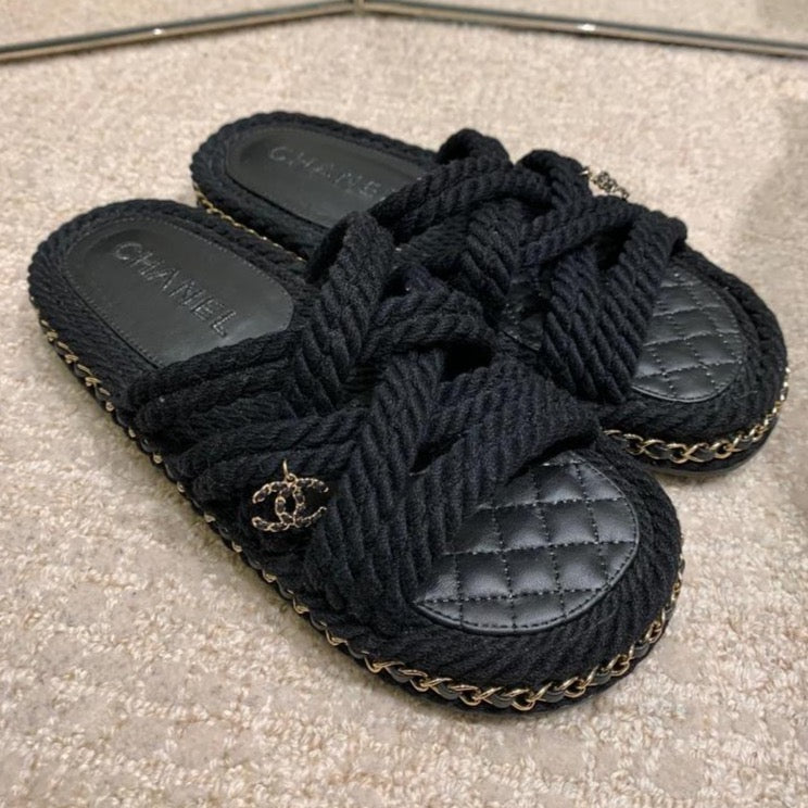 CHANEL black cord mules Cruise 2021