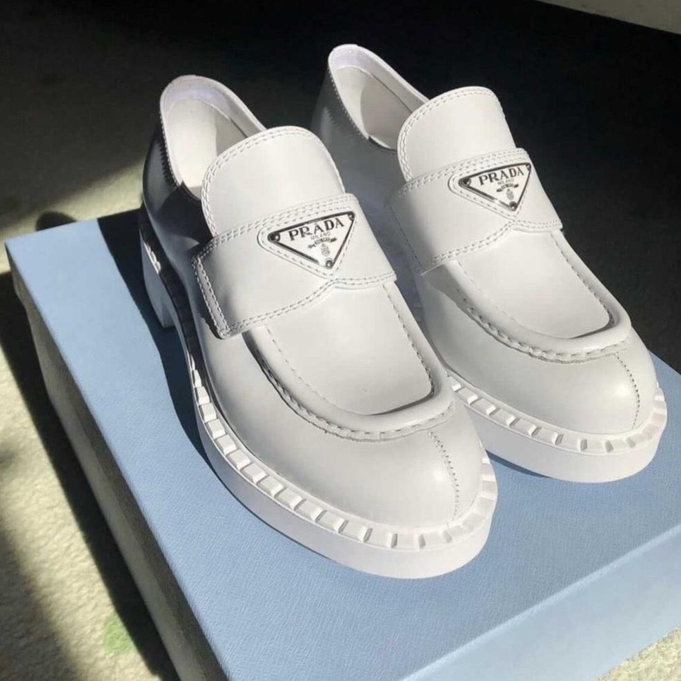 Prada white brushed leather loafers