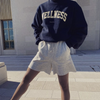 Sporty & Rich navy Wellness sweatshirt