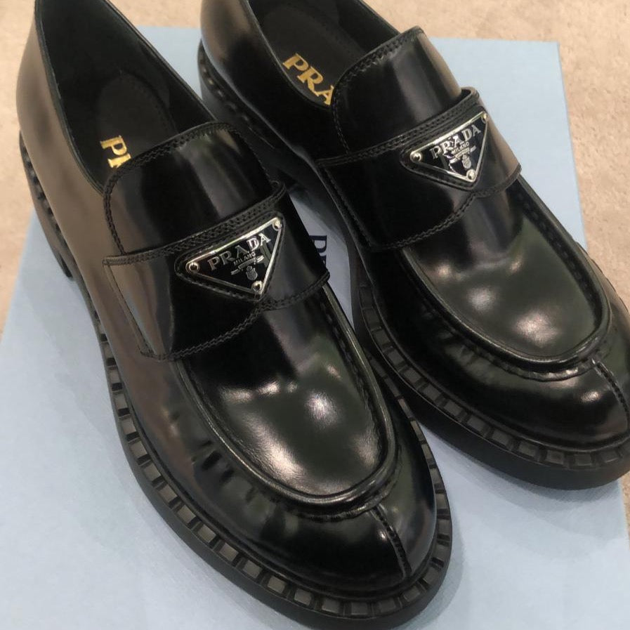 Prada black brushed leather loafers