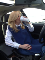 Woman Drinking Coffee in a car while wearing  an Adult Bib.