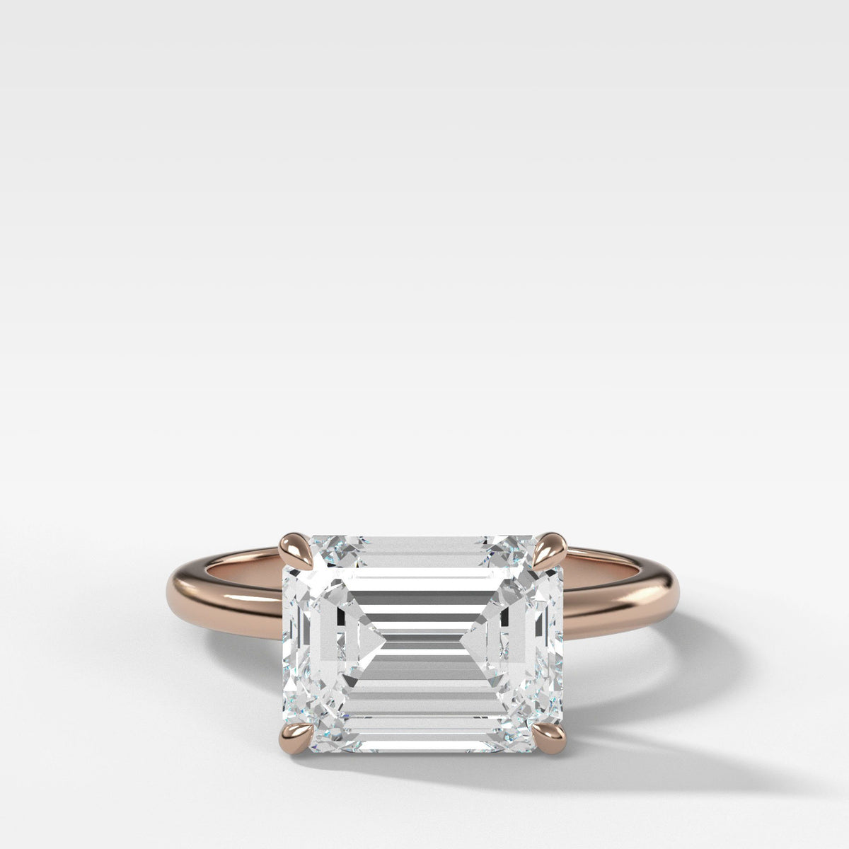 Crescent Solitaire With Emerald Cut (East West) in Rose Gold By Good Stone