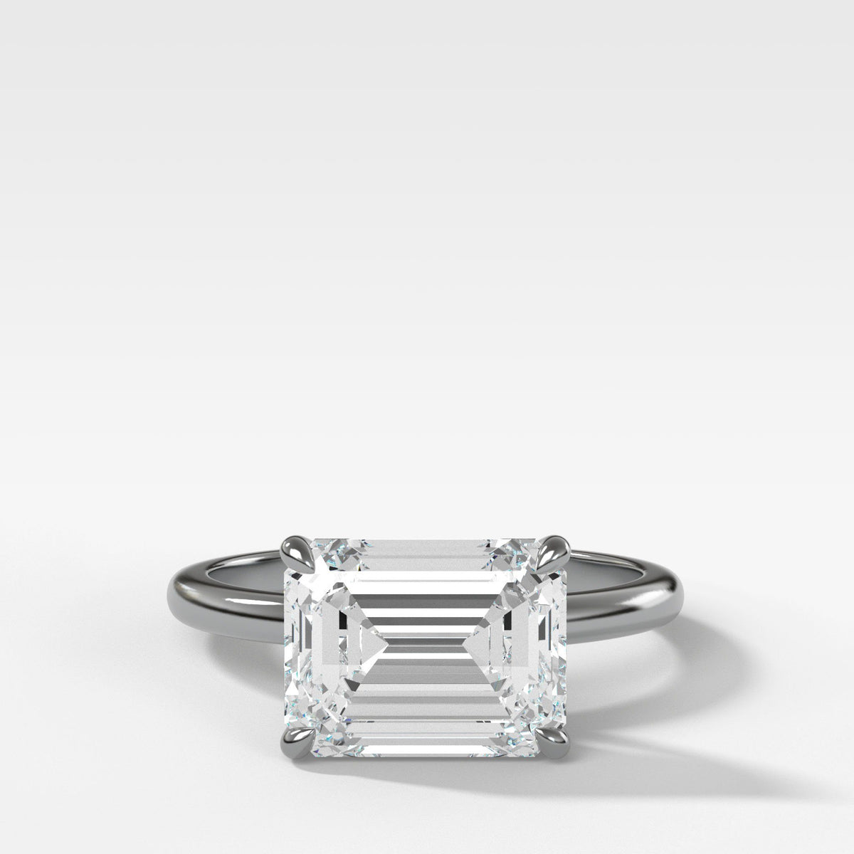 Crescent Solitaire With Emerald Cut (East West) in White Gold By Good Stone