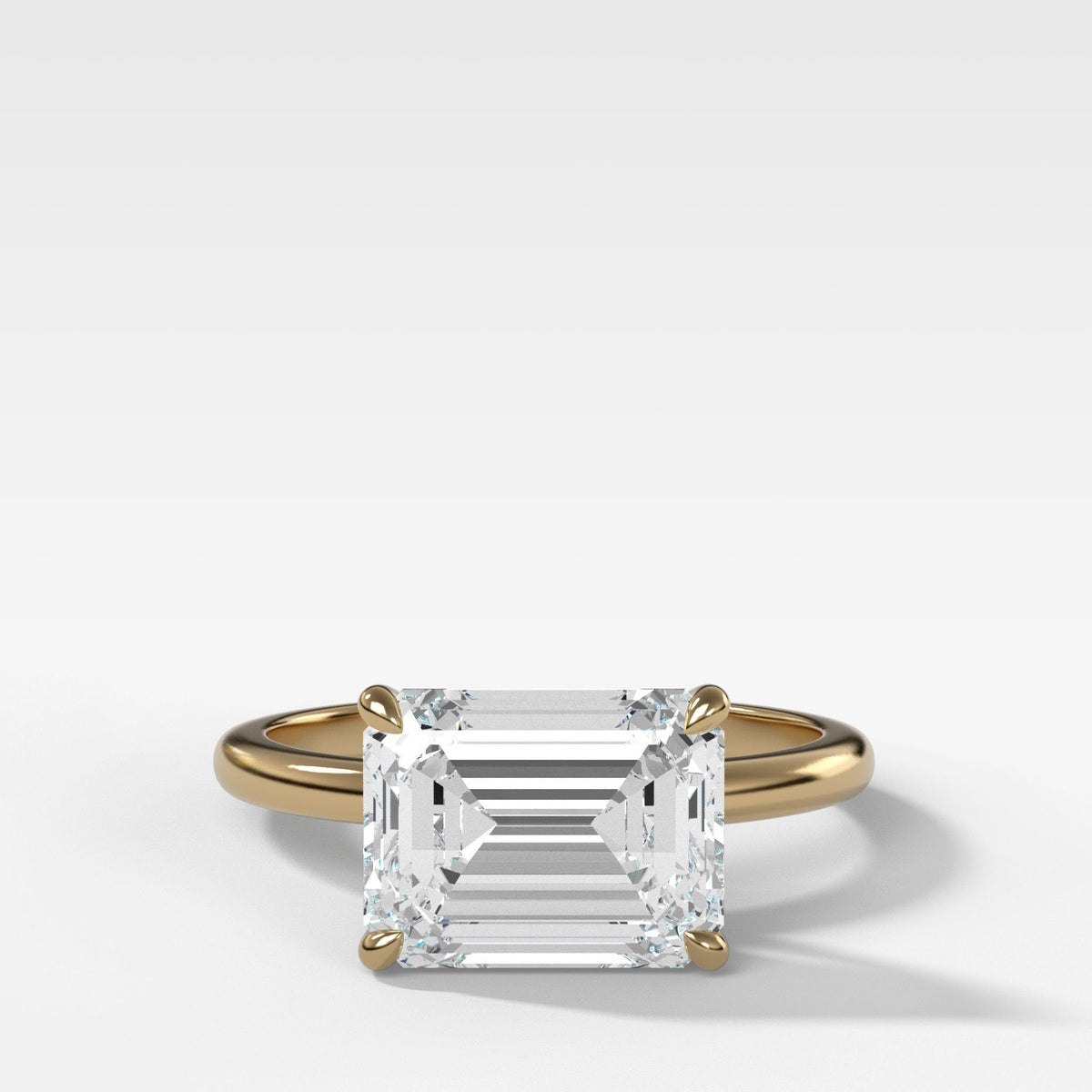 Crescent Solitaire With Emerald Cut (East West) in Yellow Gold By Good Stone