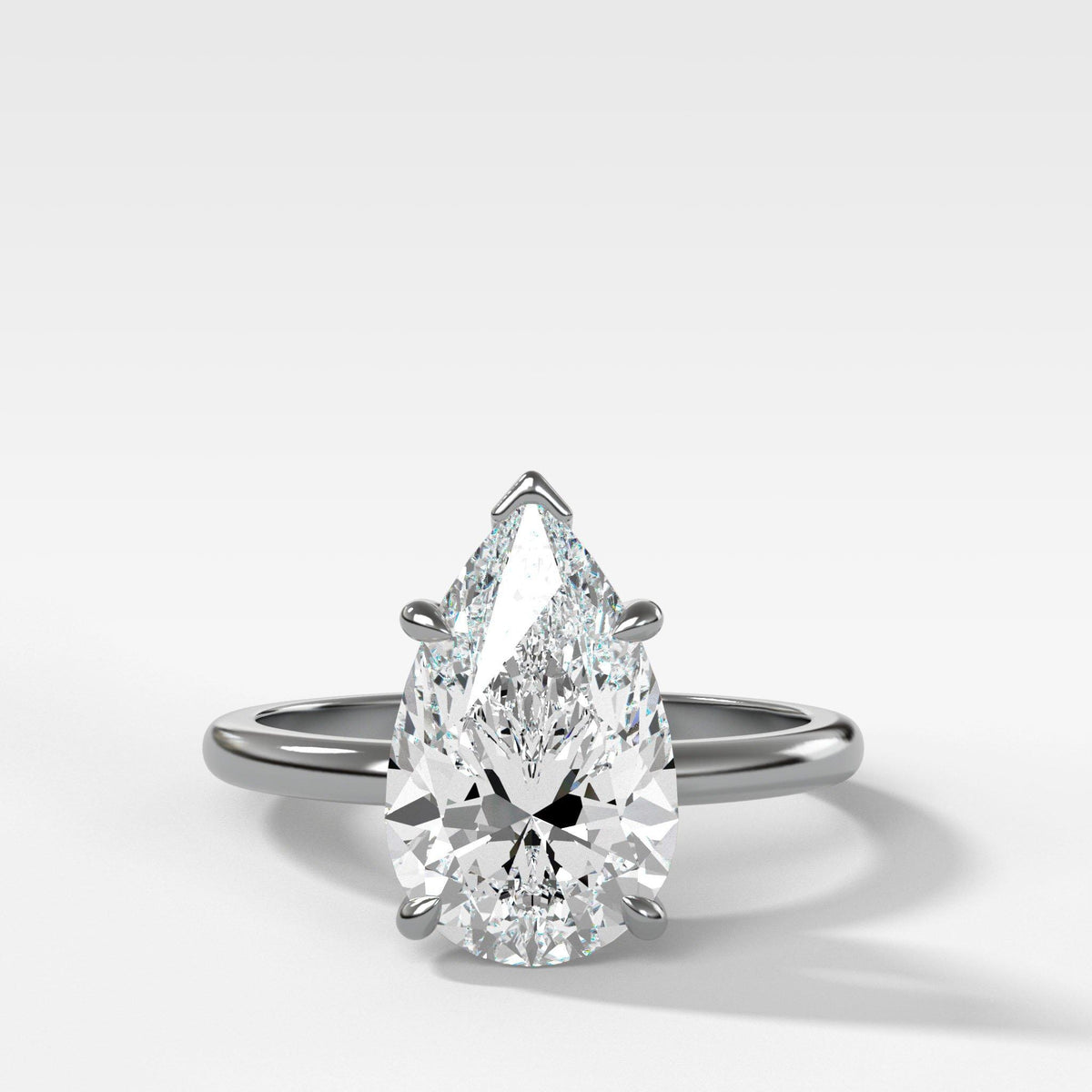 Crescent Solitaire With Pear Cut in White Gold by Good Stone