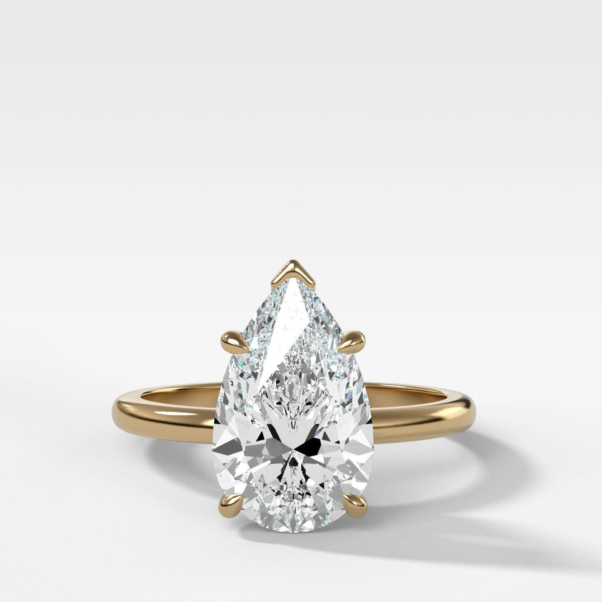 Crescent Solitaire With Pear Cut in Yellow Gold by Good Stone