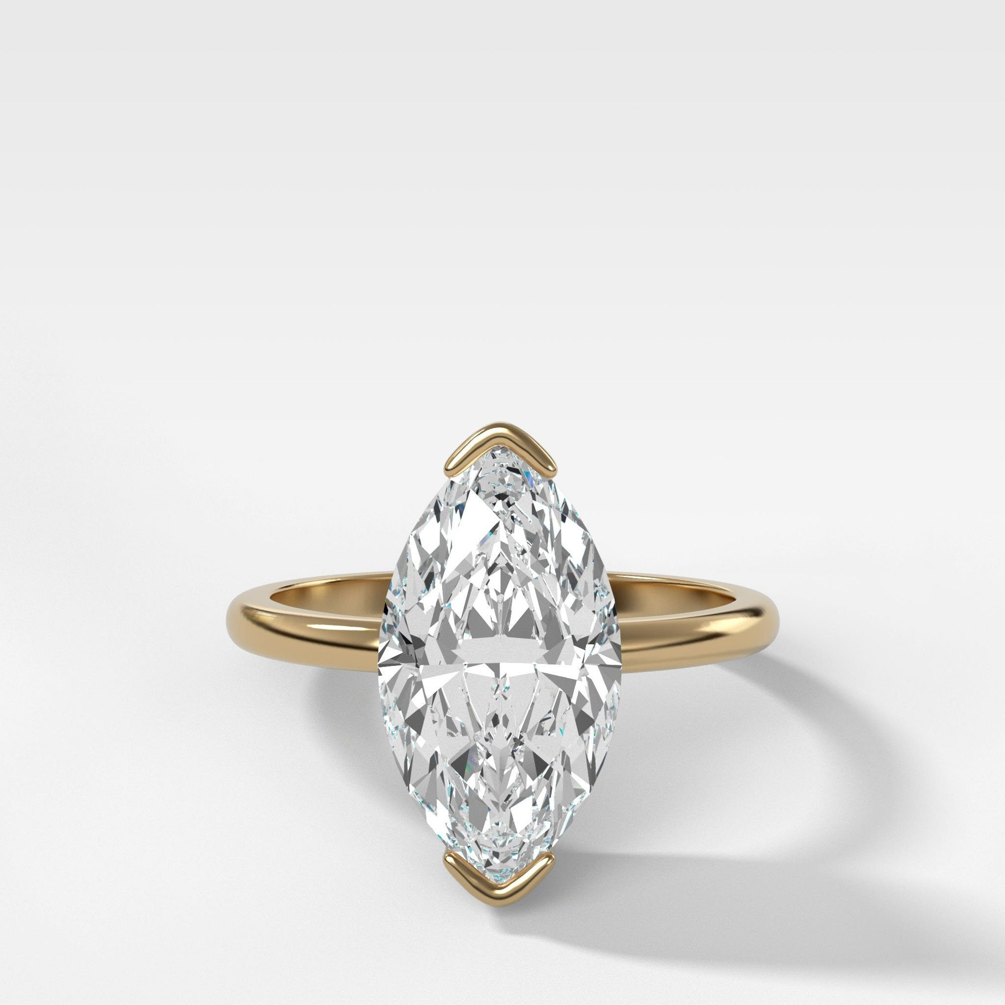 Half Bezel Solitaire Engagement Ring With Marquise Cut (North South) in Yellow Gold by Good Stone