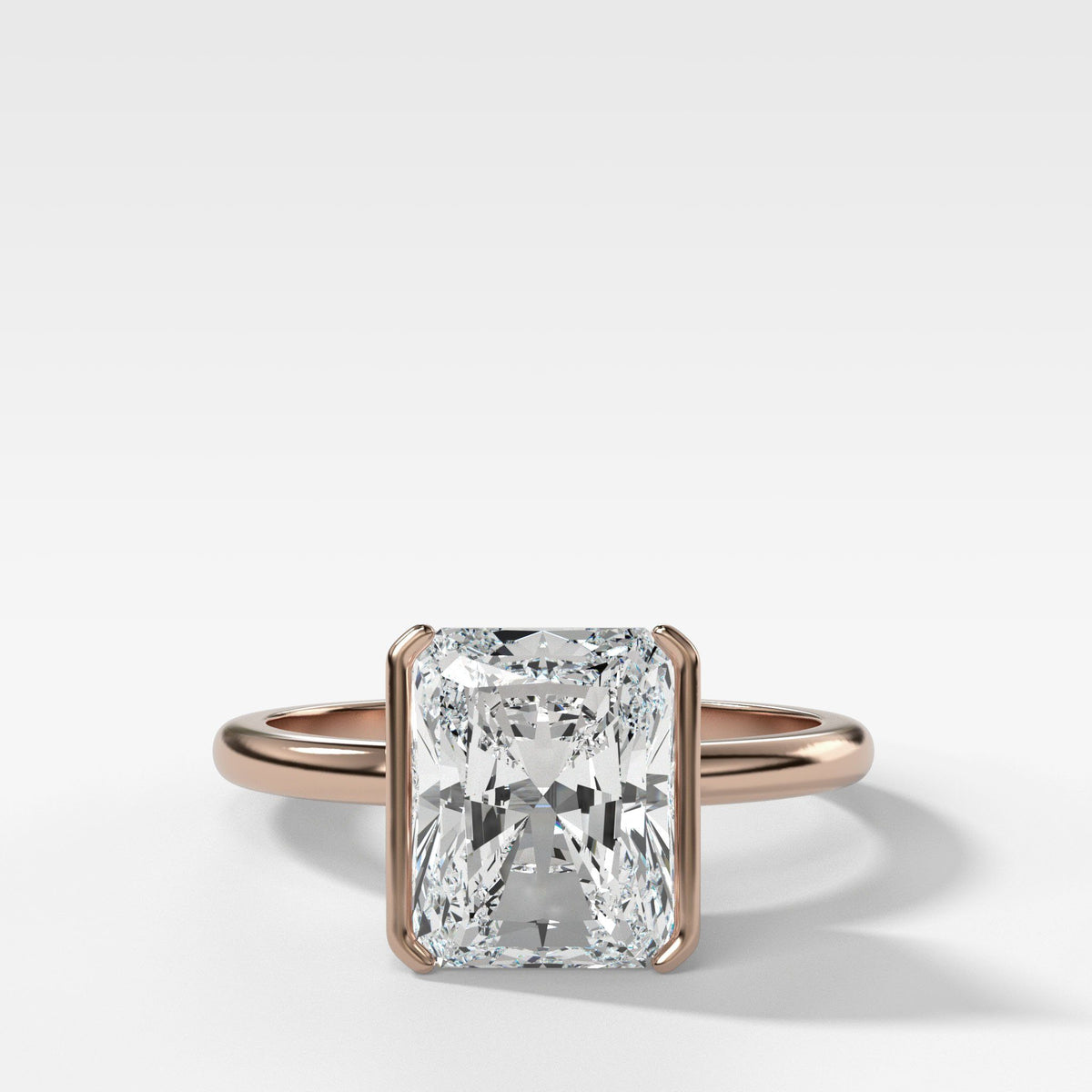 Half Bezel Solitaire Engagement ring with Elongated Radiant Cut in Rose Gold by Good Stone