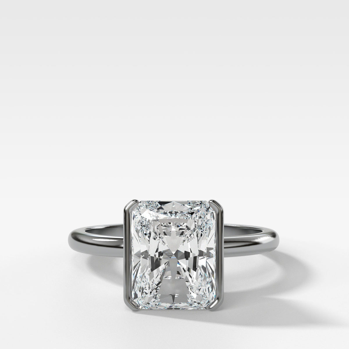 Half Bezel Solitaire Engagement ring with Elongated Radiant Cut in White Gold by Good Stone