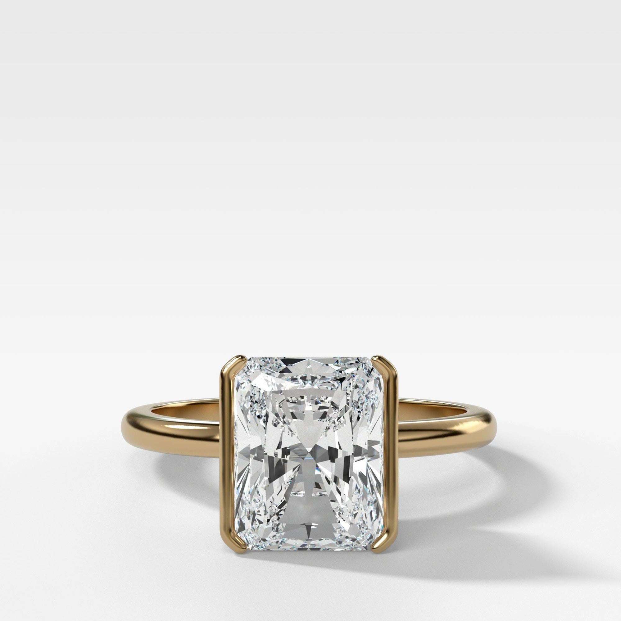 Half Bezel Solitaire Engagement ring with Elongated Radiant Cut in Yellow Gold by Good Stone