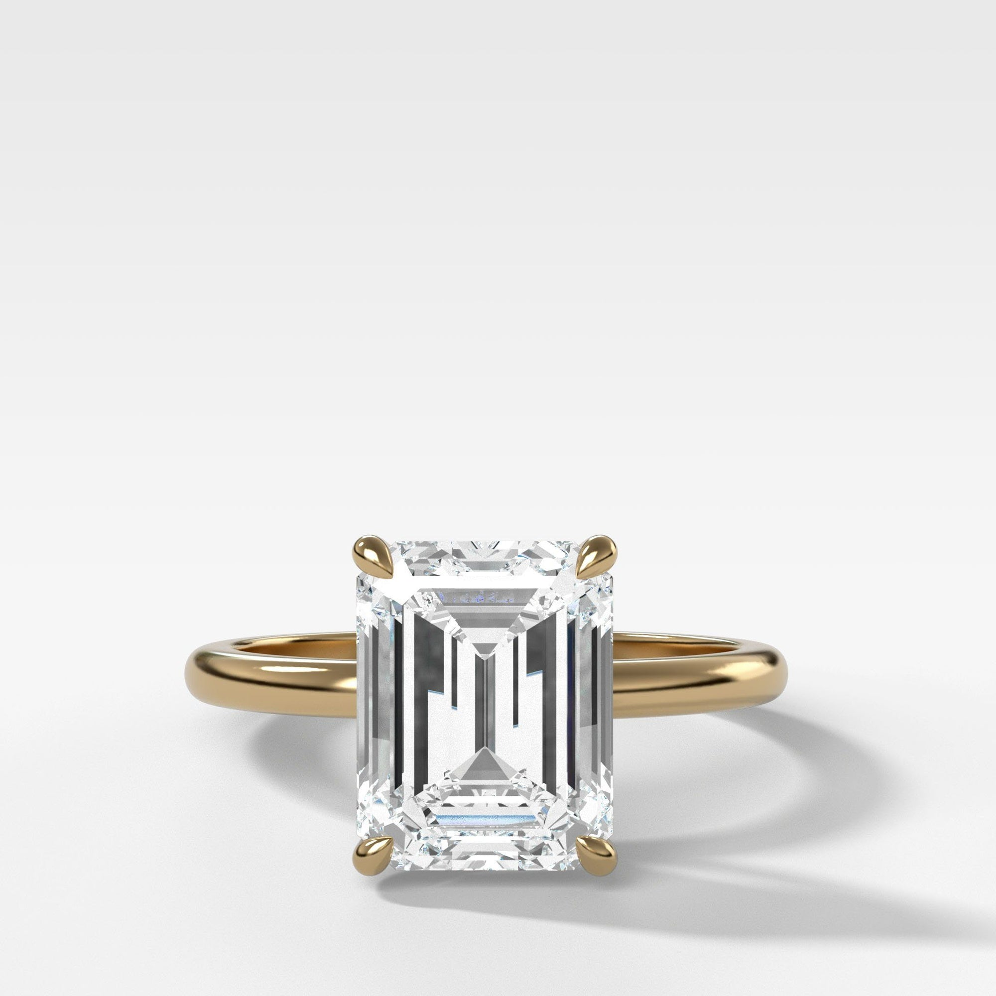 Crescent Solitaire With Emerald Cut (North South) in Yellow Gold By Good Stone