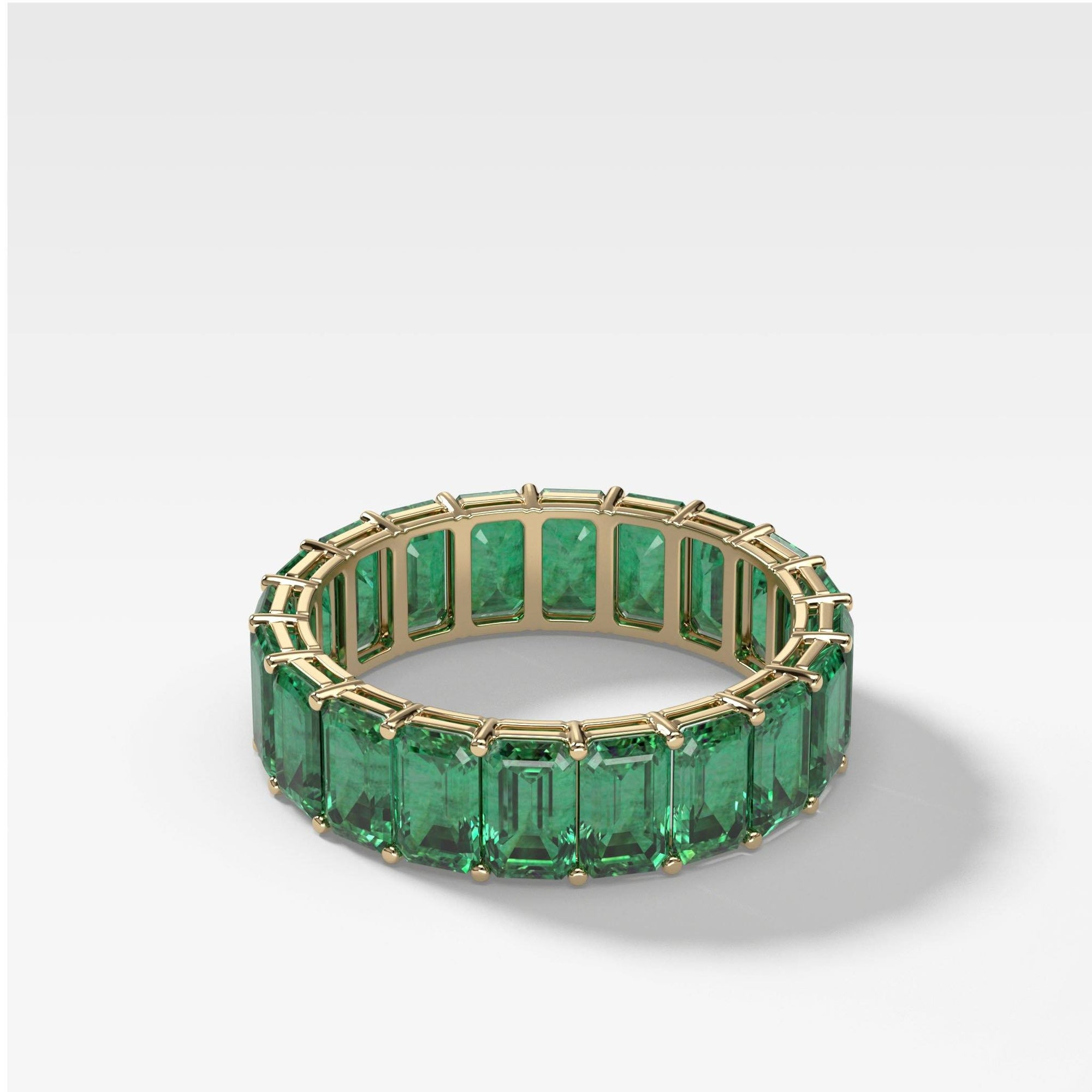Green Emerald Emerald Cut Eternity band in Yellow Gold by Good Stone