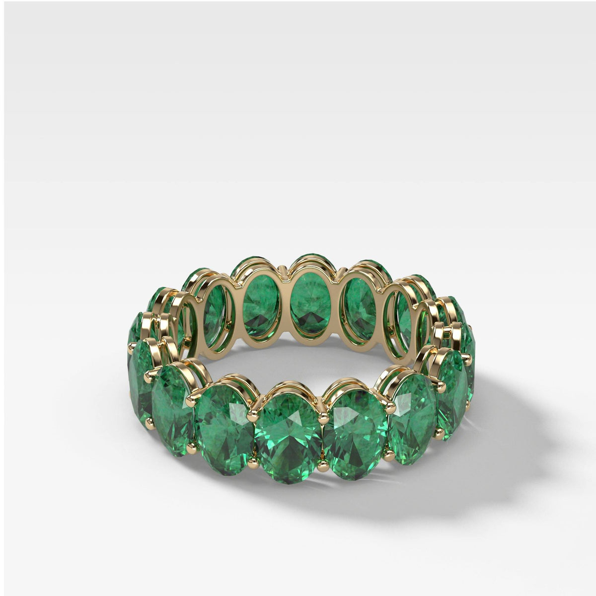 Green Emerald Oval Eternity Band in Yellow Gold by Good Stone
