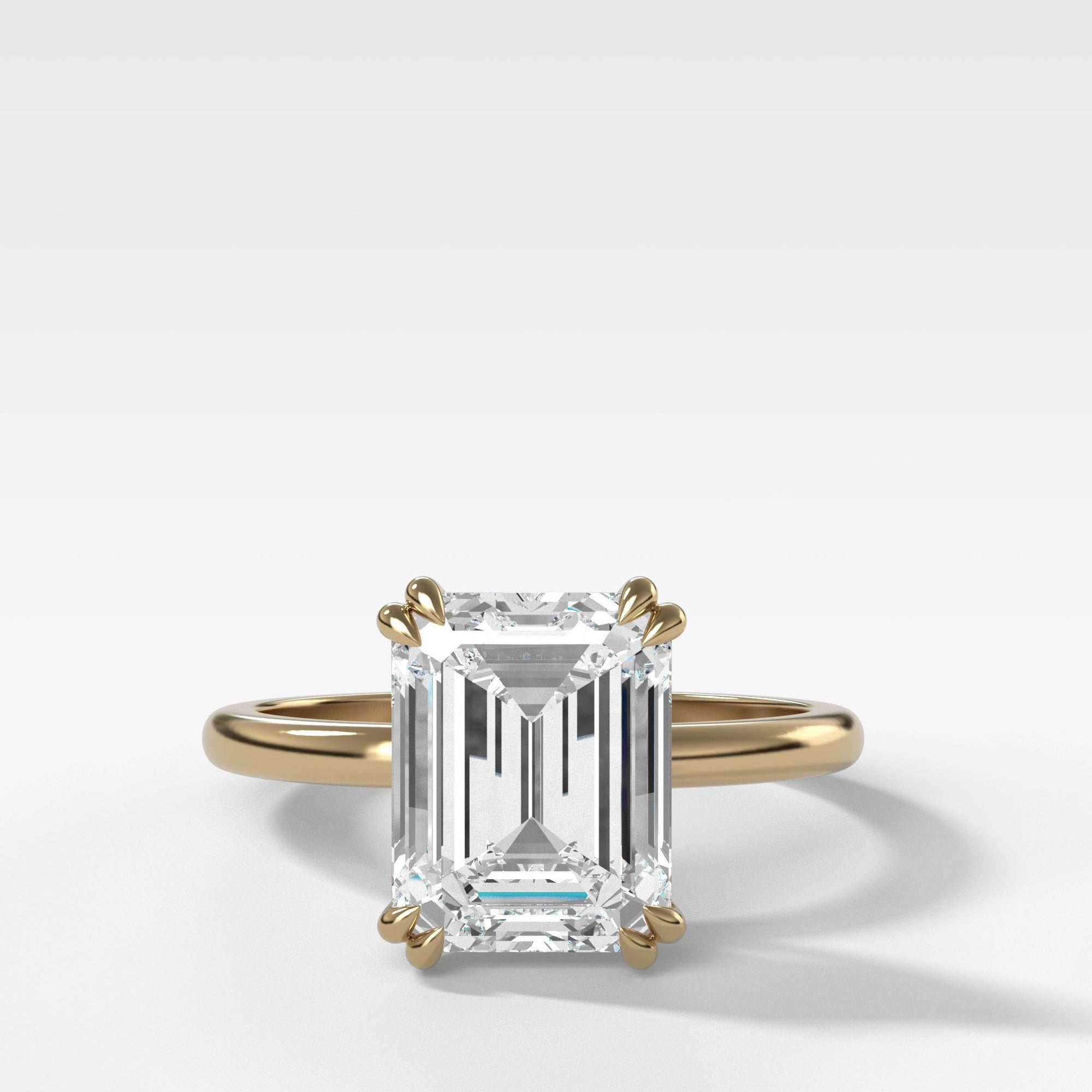 Signature Cathedral Solitaire With Emerald Cut (North South) in Yellow Gold by Good Stone