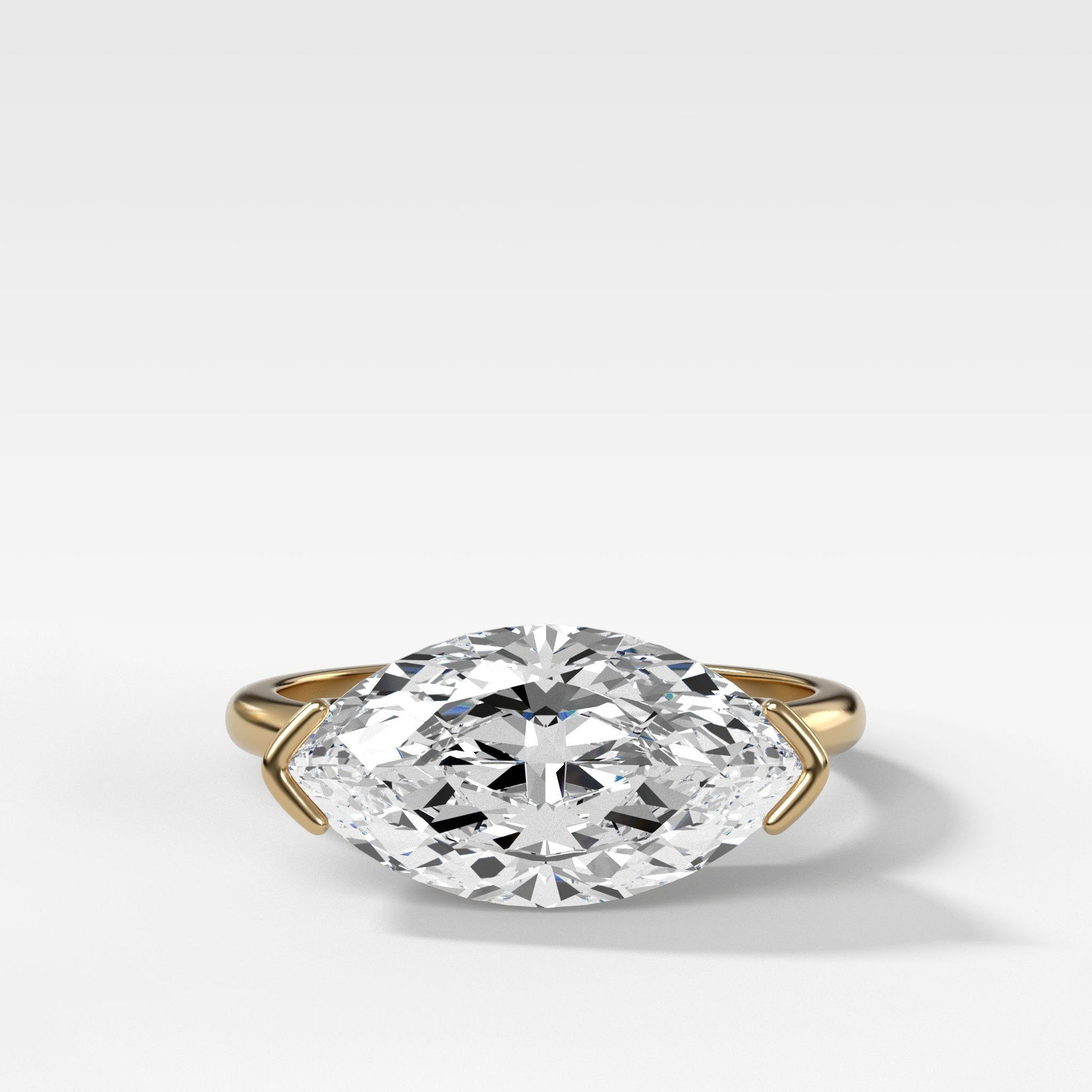 East West Half Bezel Solitaire Engagement Ring With Marquise Cut In Yellow Gold By Good Stone