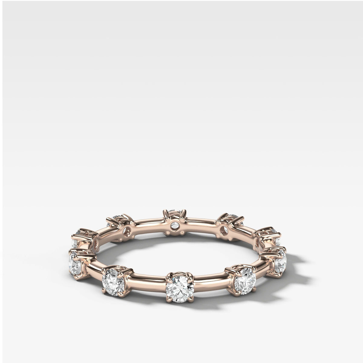 Claw Diamond Band: Spaced Eternity Band in Rose Gold by Good Stone
